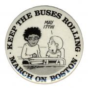 "Button showing two cartoon students and text, ""March on Boston, Keep the Buses Rolling"""