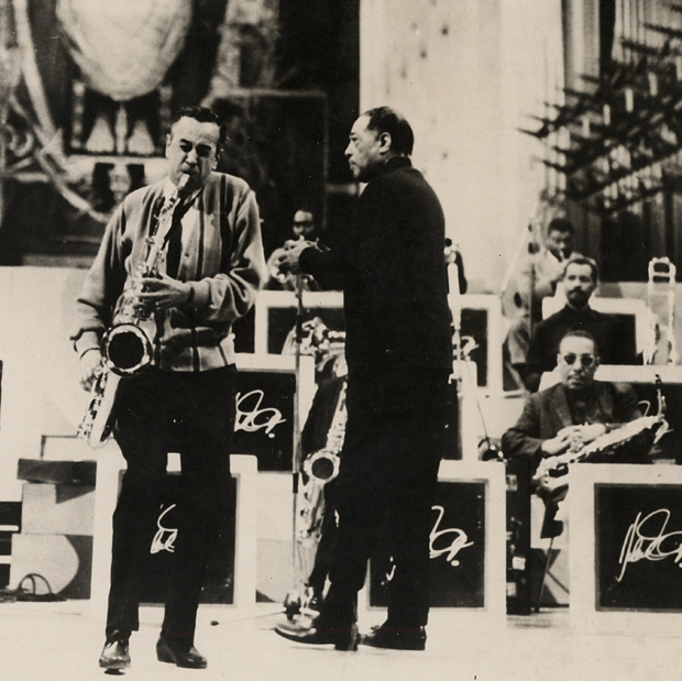 Black and white photo of tenor saxophone player and Duke Ellington