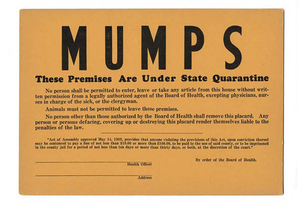 "A manilla sign with the word ""Mumps"" on it in big letters"