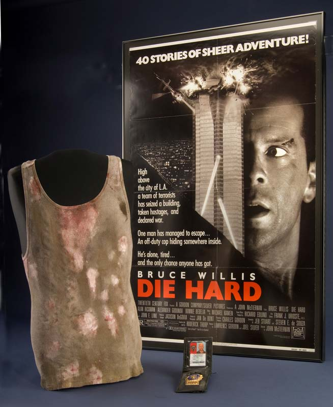 Shirt, prop badge, and poster from 'Die Hard'