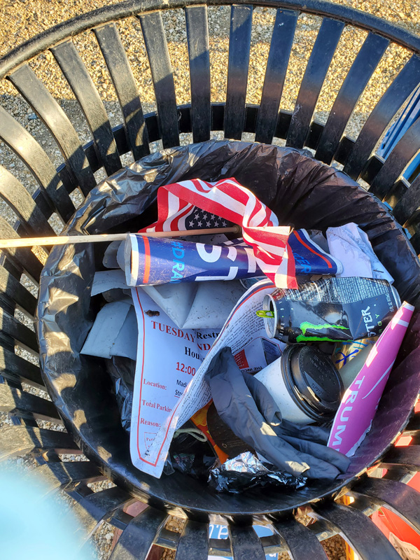 Snapshot of trashcan on the National Mall, with items including a discarded U.S. flag