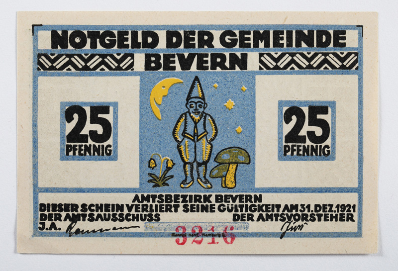25 note showing a small blue gnome