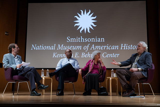 Panel of four people talking on stage
