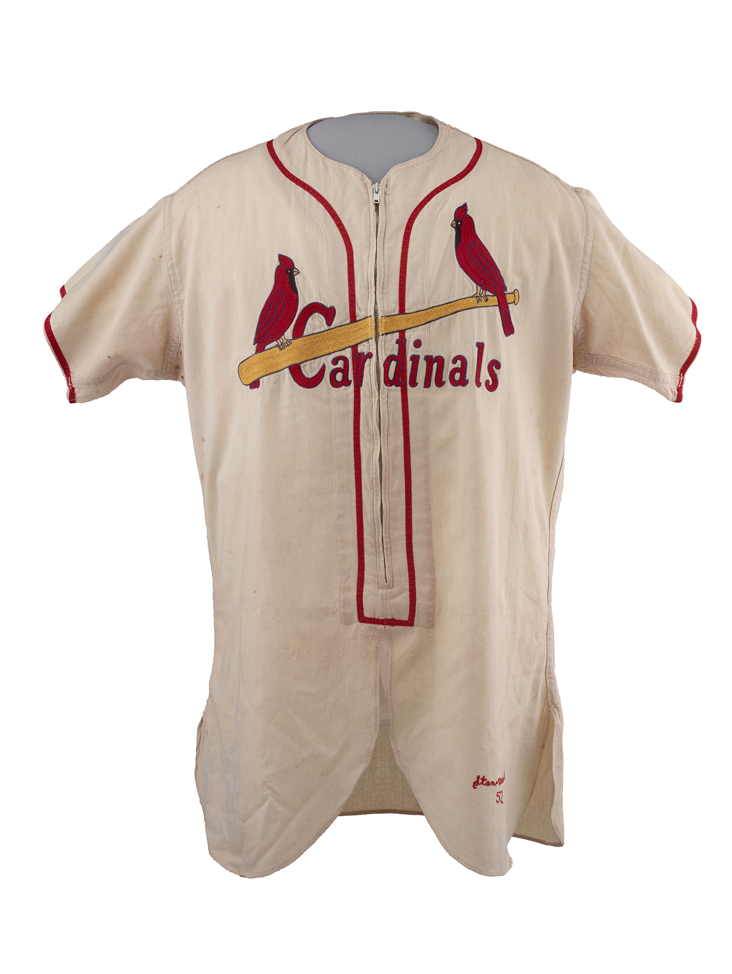 "White jersey that zippers down front with red text that says ""Cardinals."" Two cardinals sit on a baseball bat across the chest. Red detailing around arm."