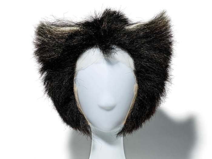 A wig of black hair that is cut flat across the top but curved around the sides.