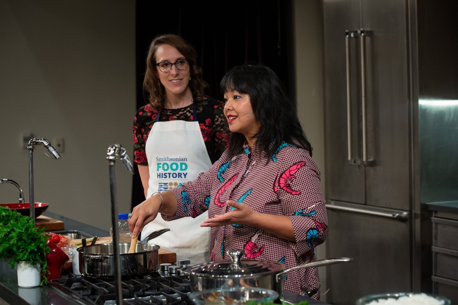 Guest Chef Genevieve Villamora Giving a Cooking Demonstration with Historian Ashley Rose Young