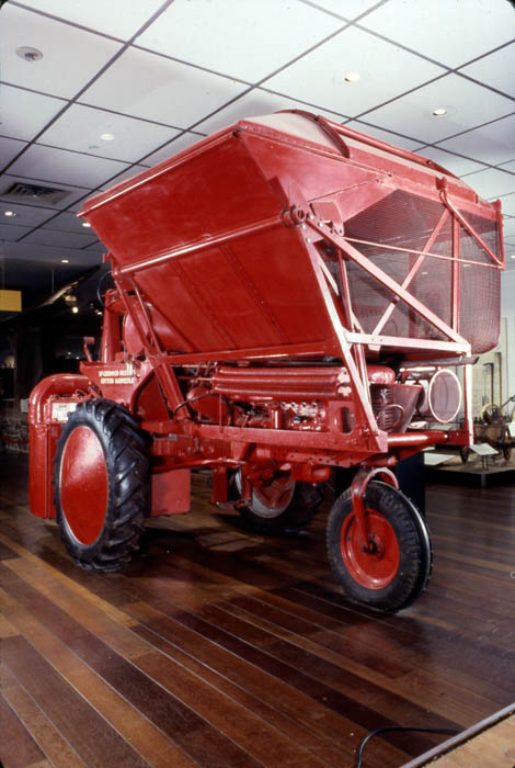 A huge red cotton picker (farm equipment)