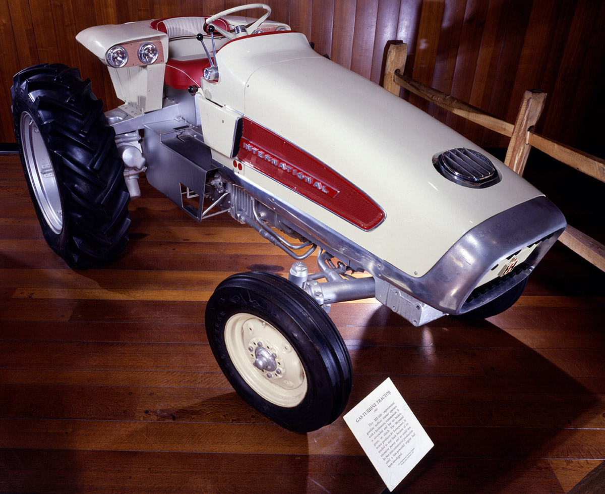A white and red turbine tractor. Its sloping sleek lines mirror those in other 1960s designs.