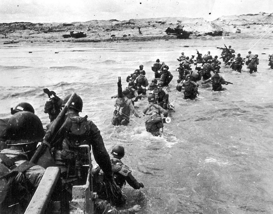 A black and white photograph of troops coming ashore on Utah Beach.