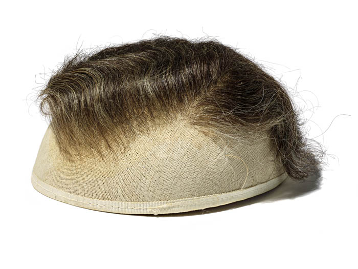 A brown toupe