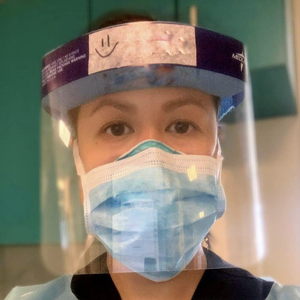 A woman in PPE.