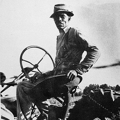 Image of a man on a tractor