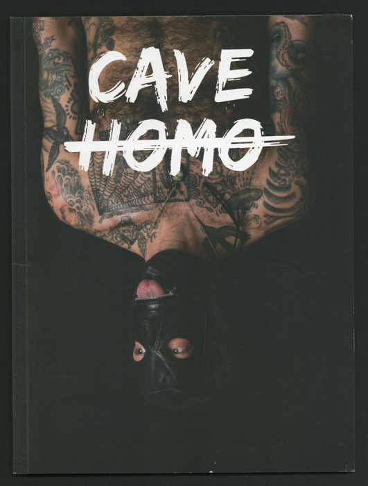 A magazine cover featuring a bare-chested man on a magazine cover with the text Cave Homo.
