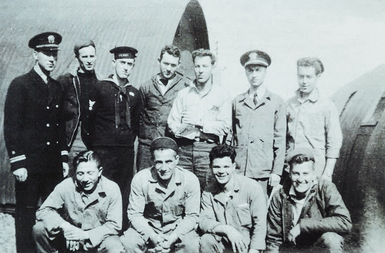 A black and white photograph of the crew of the airplane.