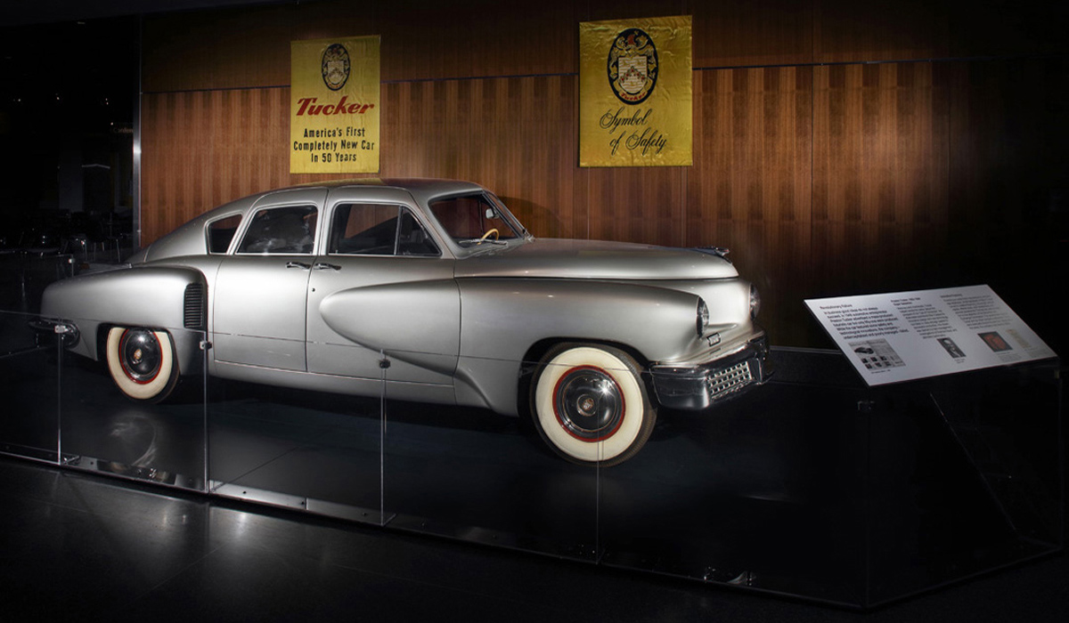 Photograph of the museum's Tucker sedan on display on the museum floor.