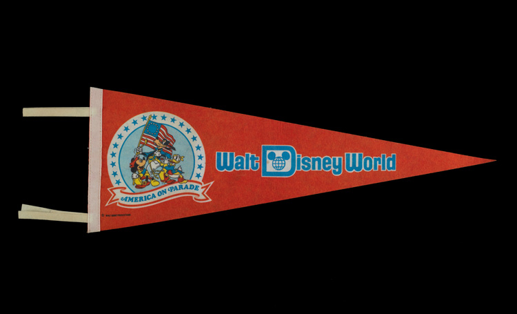 "Red flag showing Disney characters and the text ""Walt Disney World"""