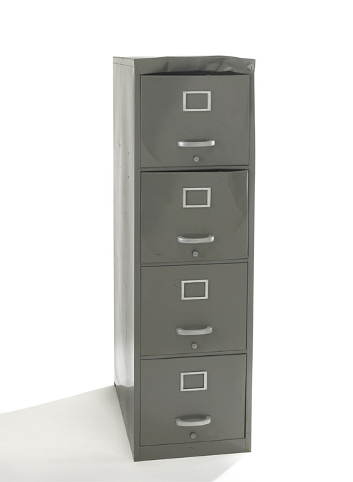 A file cabinet that has been pried open.