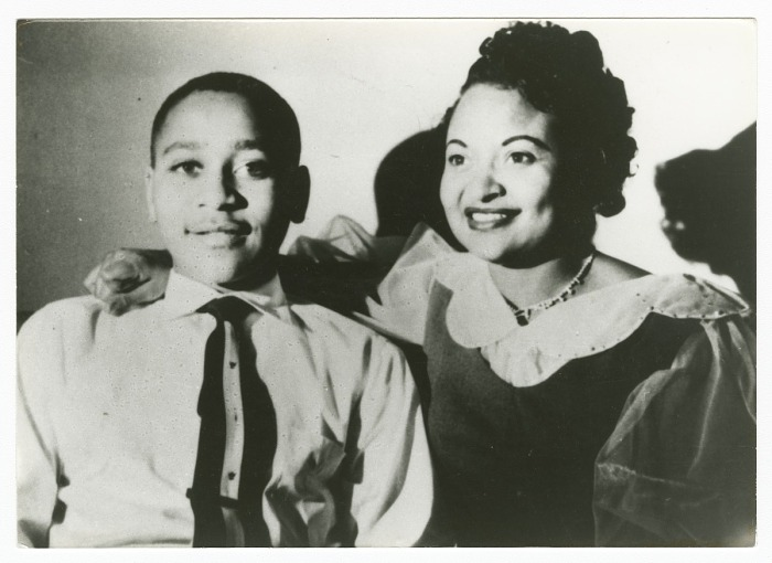 Emmett Till poses with his mother. Both are smiling.