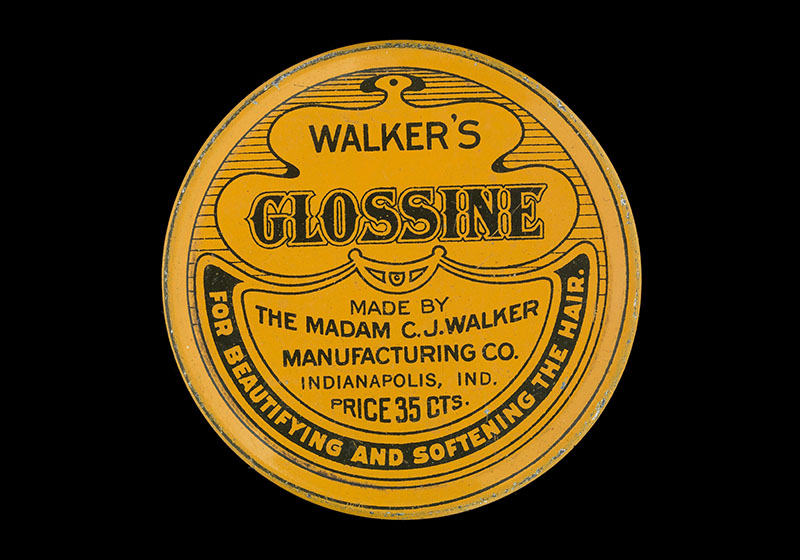 "A round yellow tin. The top reads ""Walker's Glossine"""