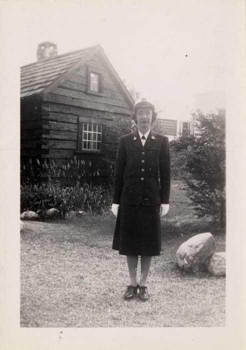 Grace Hopper stands in her uniform.