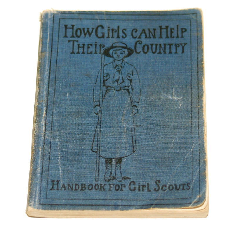 "Girl Scout manual, ""How Girls Can Help Their Country,"" with illustraton of scout on cover"