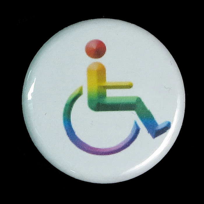 A button with the wheelchair symbol in rainbow.