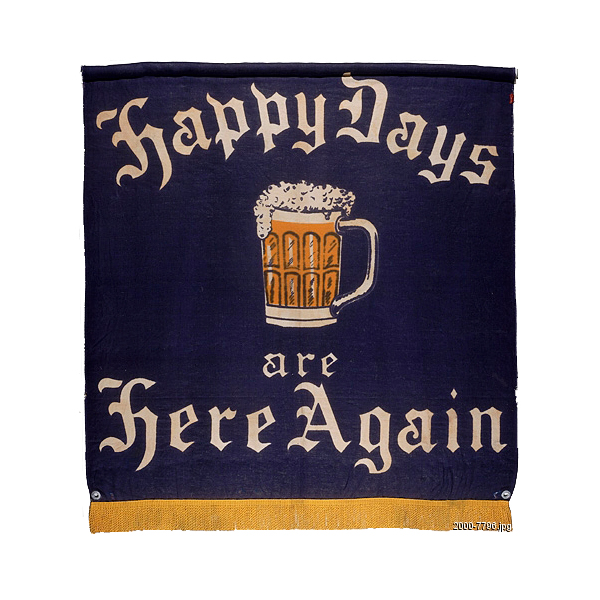 "A banner with a glass of beer on it that reads ""Happy days are here again."""