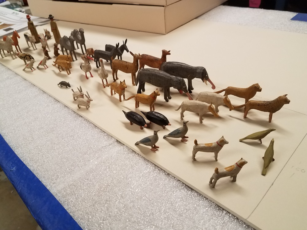 Wooden carved animals lined up