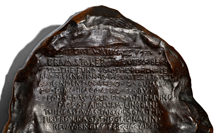Close-up of the back of Abraham Lincoln life mask, showing plate with Bram Stoker's name