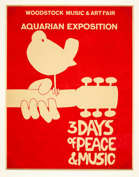 "A red poster with a graphic. The graphic is a neck of a guitar with a hand on it as though playing it. A bird rests on the guitar. The text reads ""Woodstock Music & Art Fair, Aquarian Exposition, 3 Days of Peace & Music"""
