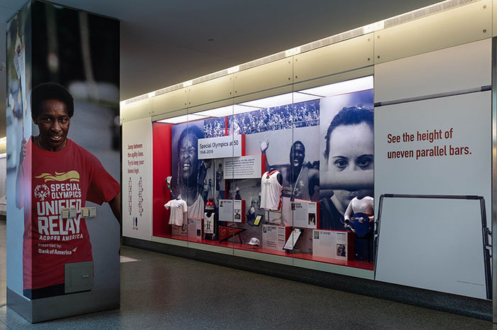 A photograph of the museum's Special Olympics at 50 case, featuring photographs of athletes and objects.