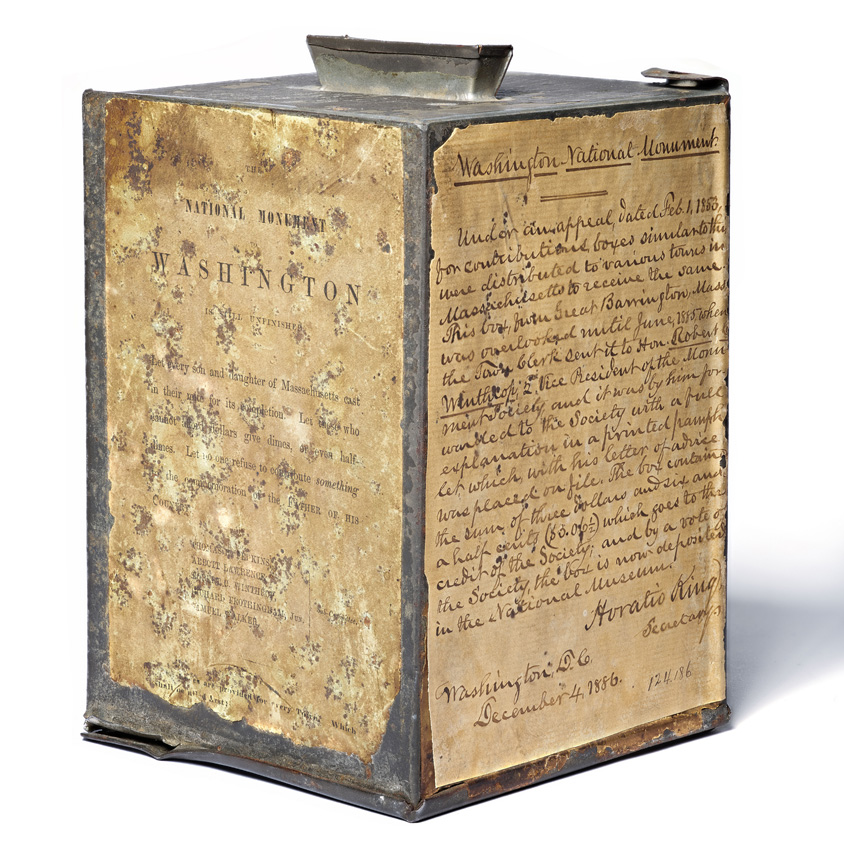 Metal collection box with handwritten instructions attached to side