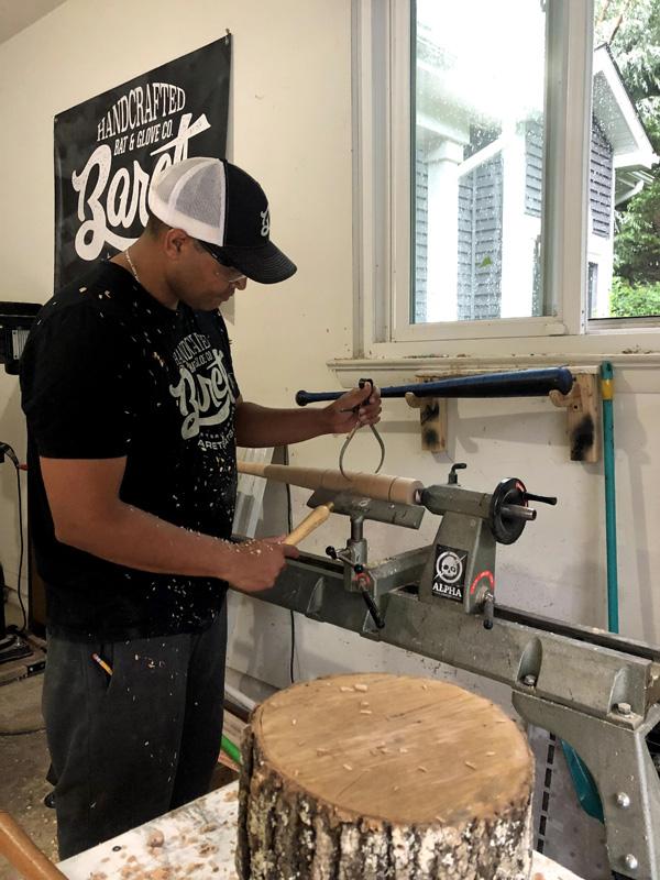 Juan Baret working on a bat