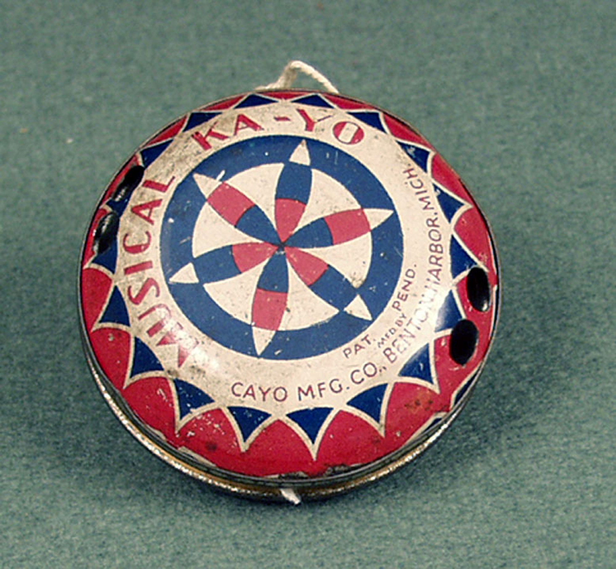 Red white and blue metal yo-yo with flower design at the center