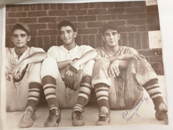 Photograph of baseball players in uniform, sitting