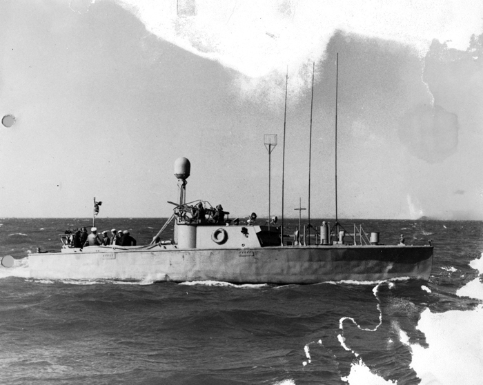 A black and white photograph of a military ship