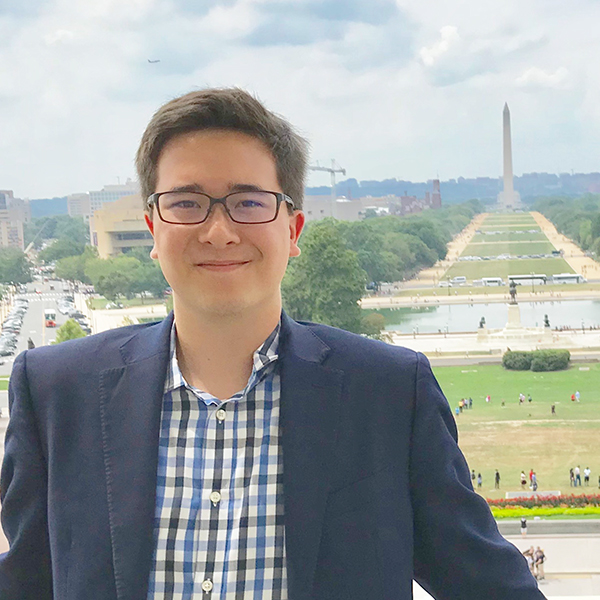 A young man in front of the Washington Monument.