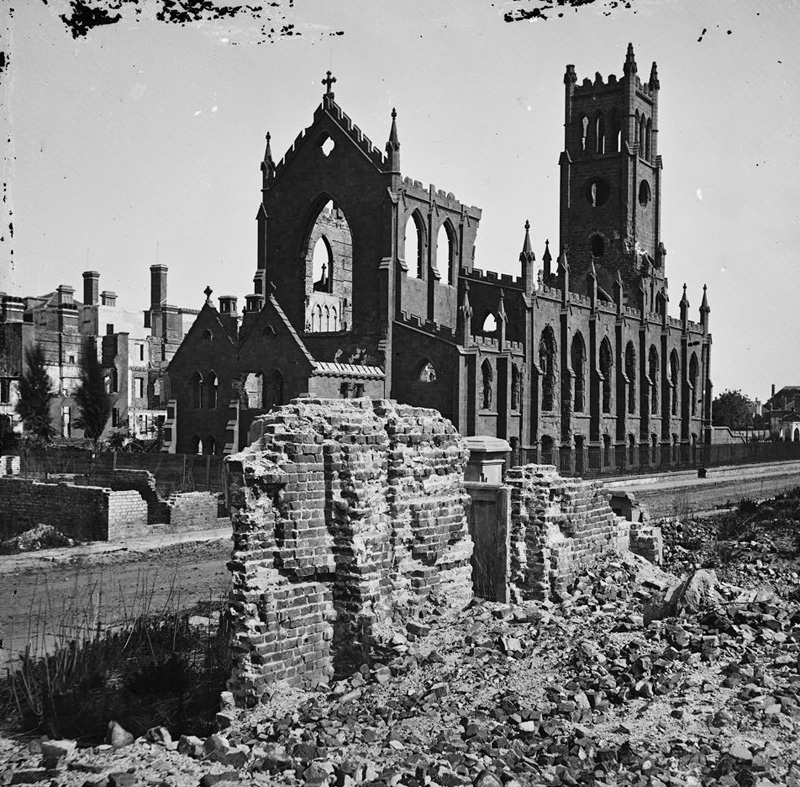 The surviving brick structure of the Catholic Cathedral of St. John and St. Finbar, after the Great Fire of 1861