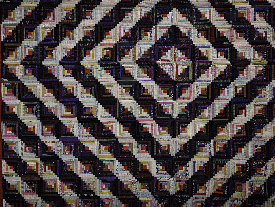 A detail of a log cabin quilt.