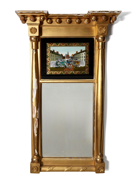 A gold mirror with an illustration of the Boston Massacre at the top.