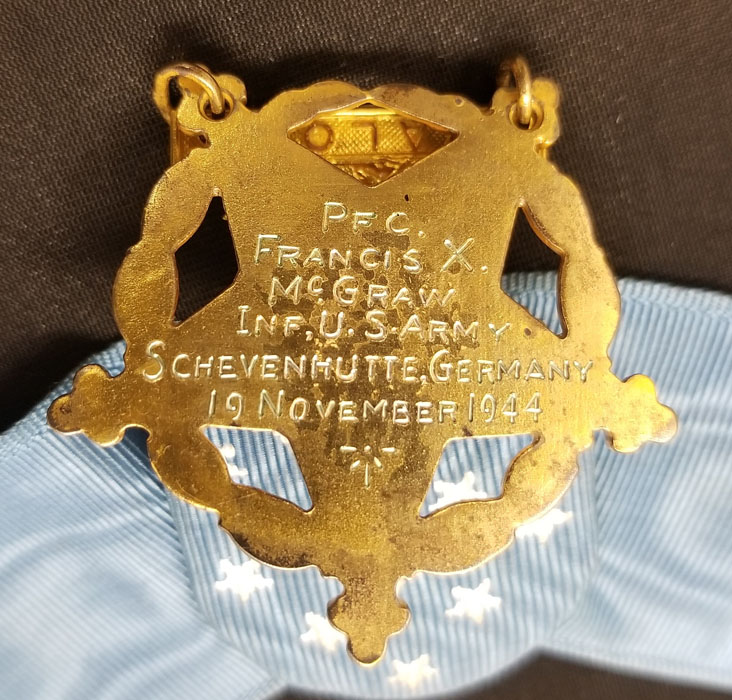 "A medal with the engraving ""PFC. Francis X McGraw Inf. U.S. Army. Schevenhutte, Germany. 19 November 1944."