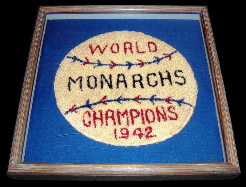 "Jacket patch designed to look like a baseball with text: ""World Monarchs Champions 1942"""