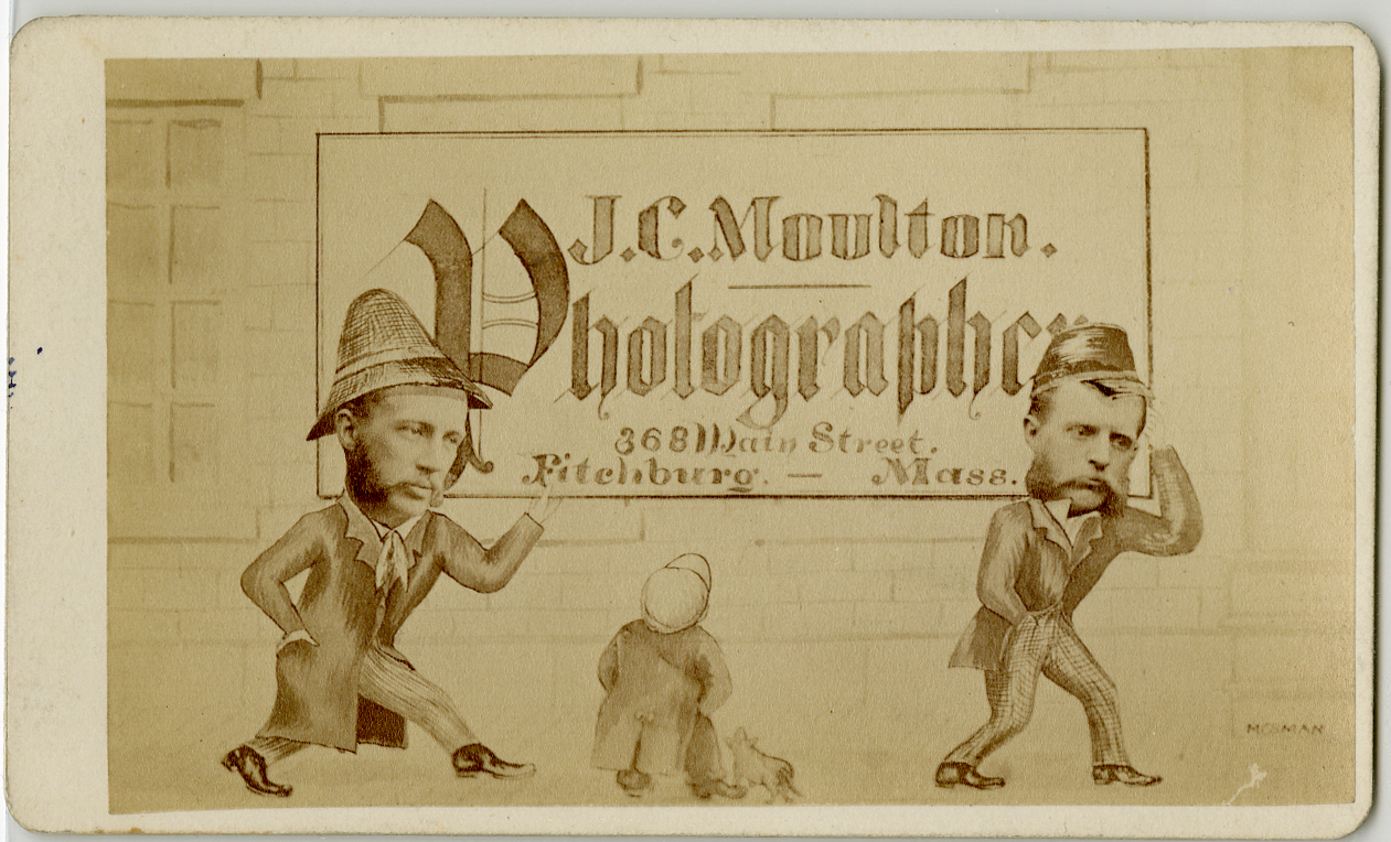 Two men with sketched bodies and photo faces carry a large business sign, while a boy and his dog look on