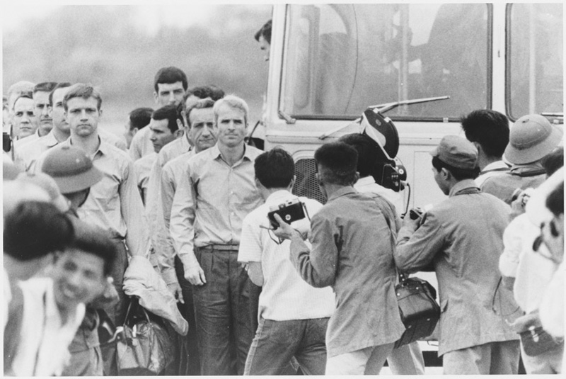 Photograph of John McCain and other returning soldiers