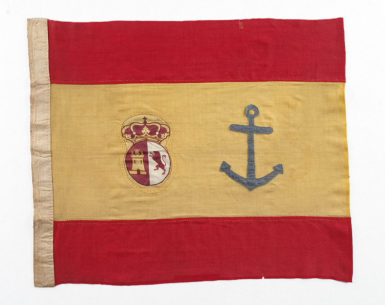 Spanish flag with large yellow stripe with anchor and coat of arms. Red stripes on either side of yellow.