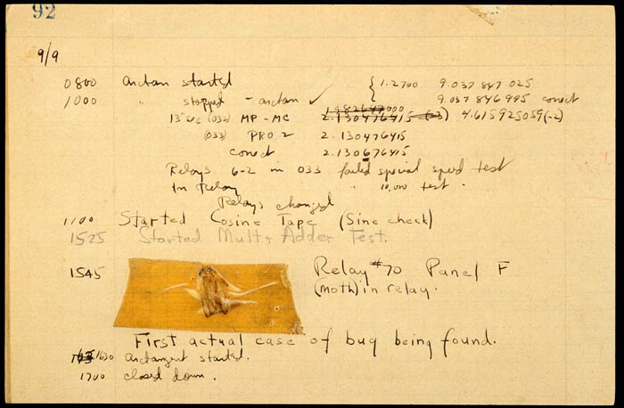 "A piece of a log book with handwritten notes with a bug taped to it. Beneath it the text reads ""First actual case of bug being found."""