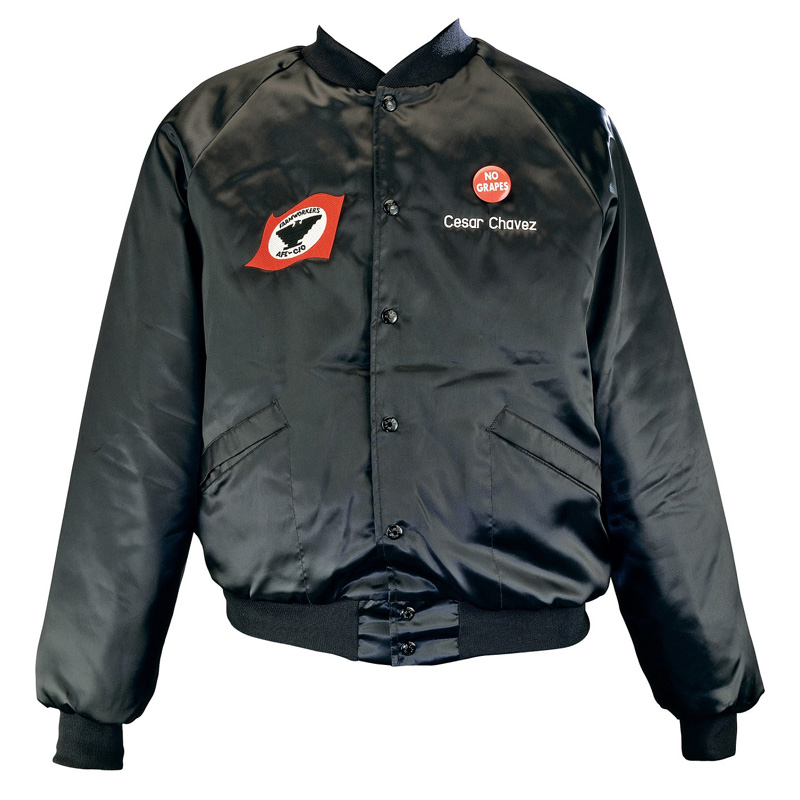 """Black leather jacket decorated on the right breast with the symbol of the United Farm Workers. The name """"Cesar Chavez"""" is written on the left breast"""