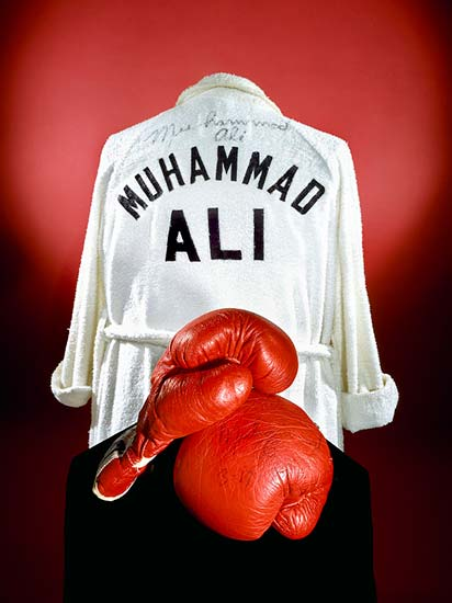 Robe with lettering 'Muhammad Ali' shown with red boxing gloves