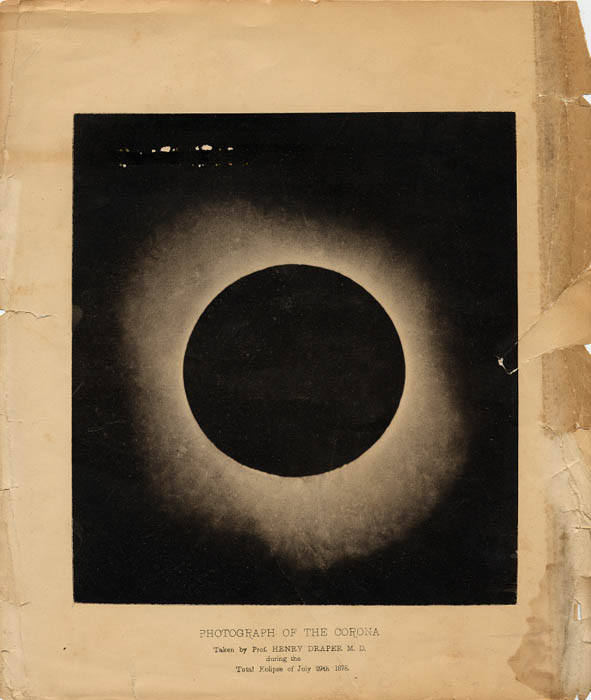 On a manilla piece of paper, this photograph shows the brilliant cornea around the sun--visible during an eclipse.