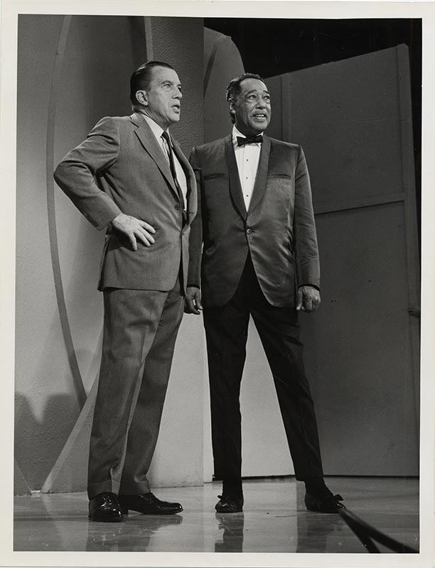 Two men on a television stage